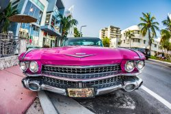 ST Cadillac Vintage car parked at Ocean Drive in Miami Beach Florida